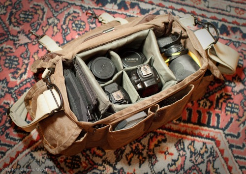 A photojournalist's camera bag and contents