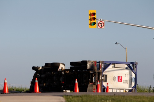 Rolled-over truck on Dorval Drive in Oakville