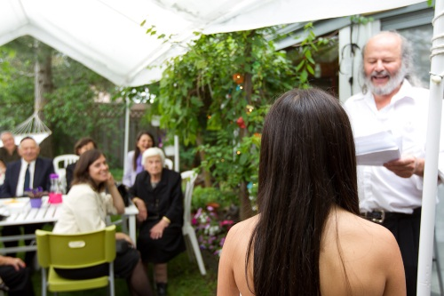 Dad holds a speech for his Bat Mitzvah daughter. Photograph by Michael Willems