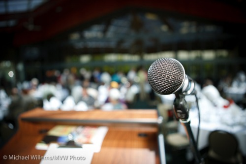 Microphone shot against blurry background, by photographer Michael Willems