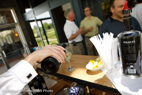 Wine being poured at a reception, photograph by Michael Willems